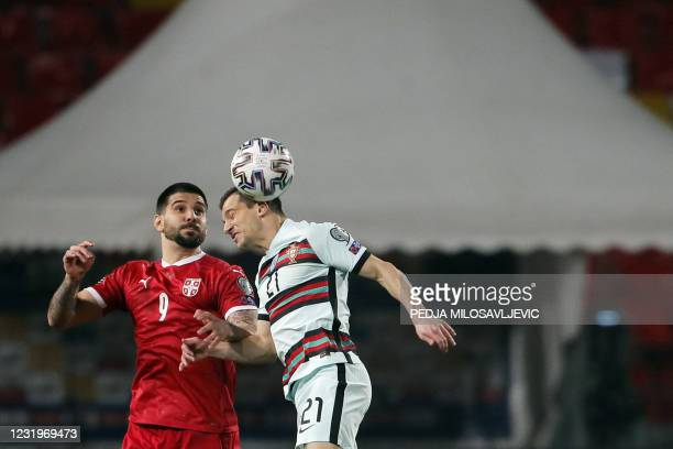 Portugal's defender Cedric fights for the ball with Serbia's forward Aleksandar Mitrovic during the FIFA World Cup Qatar 2022 qualification Group A...