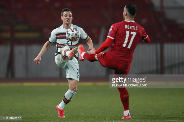 Portugal's defender Cedric fights for the ball with Serbia's midfielder Filip Kostic during the FIFA World Cup Qatar 2022 qualification Group A...