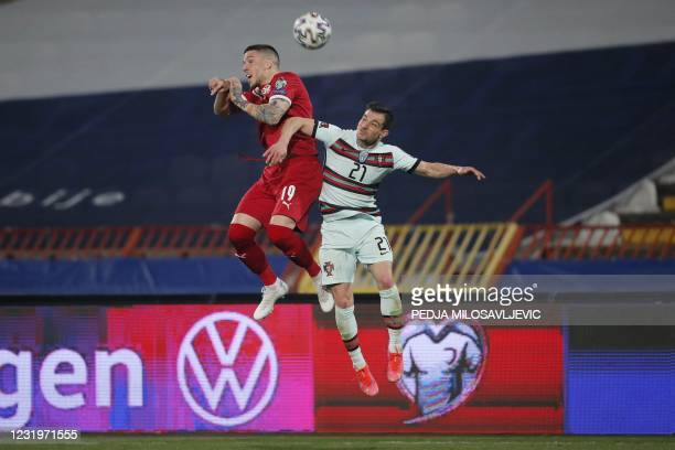 Portugal's defender Cedric fights for the ball with Serbia's midfielder Mihailo Ristic during the FIFA World Cup Qatar 2022 qualification Group A...