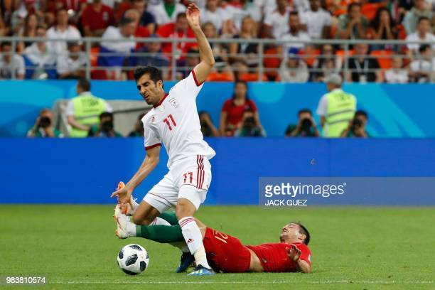 Portugal's defender Cedric Soares tackles Iran's forward Vahid Amiri during the Russia 2018 World Cup Group B football match between Iran and...
