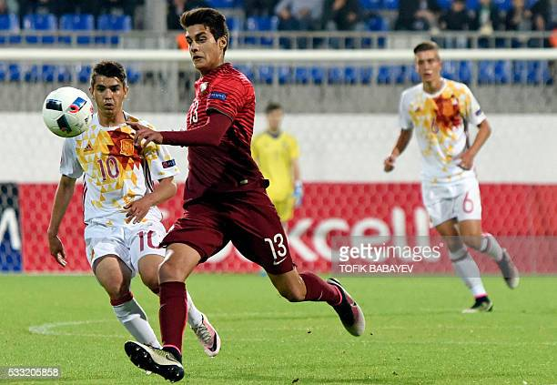 Portugal's defender Diogo Leite vies for a ball with Spain's midfielder Brahim Diaz during the 2016 UEFA European Under17 Championship final football...