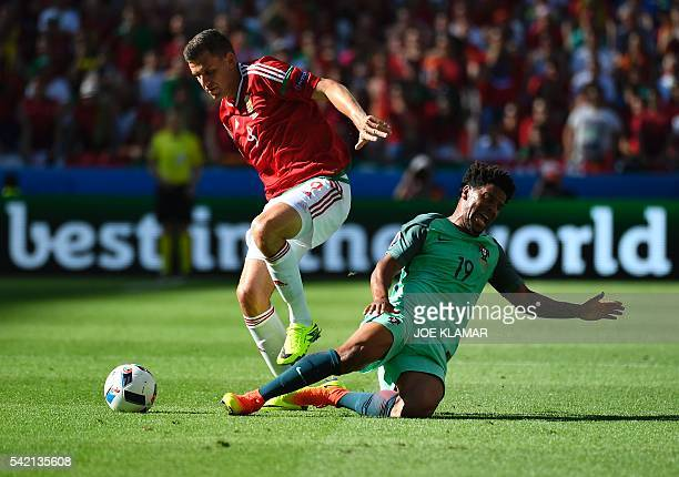 Portugal's defender Eliseu vies for the ball with Hungary's forward Adam Szalai during the Euro 2016 group F football match between Hungary and...