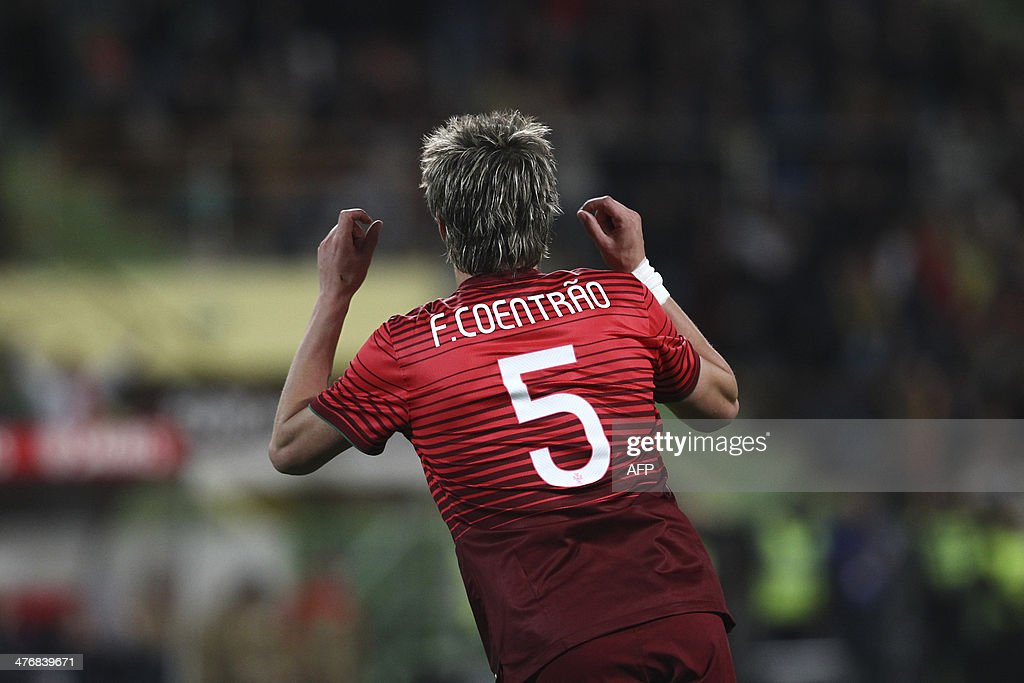 Portugal's defender Fabio Coentrao celebrates after scoring during the FIFA 2014 World Cup friendly football match Portugal vs Cameroon at Magalhaes Pessoa stadium in Leiria on March 5, 2014.