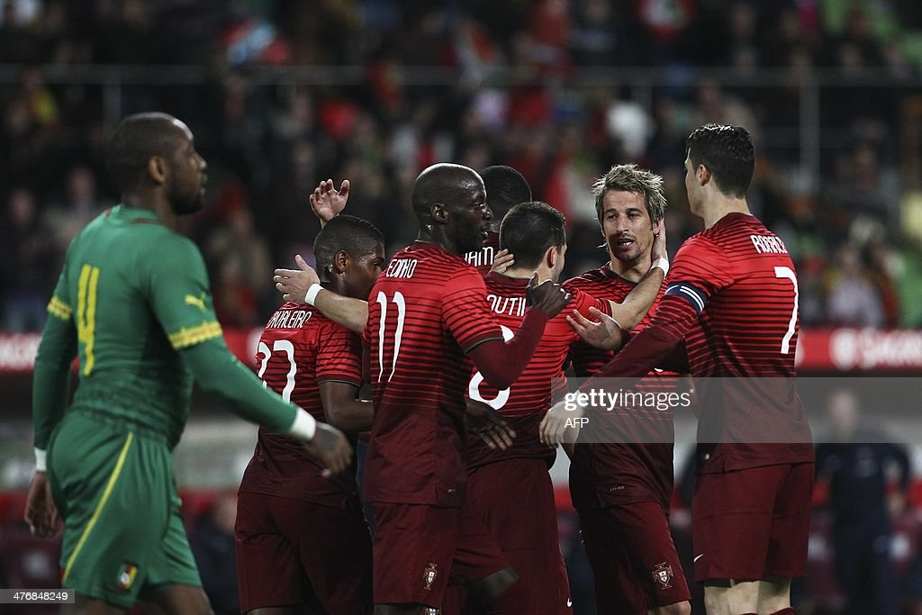 Portugal's defender Fabio Coentrao (2nd R) celebrates with his teammates after scoring during the FIFA 2014 World Cup friendly football match Portugal vs Cameroon at Magalhaes Pessoa stadium in Leiria on March 5, 2014.