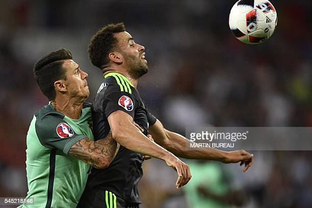 TOPSHOT Portugal's defender Fonte vies for the ball against Wales' forward Hal RobsonKanu during the Euro 2016 semifinal football match between...