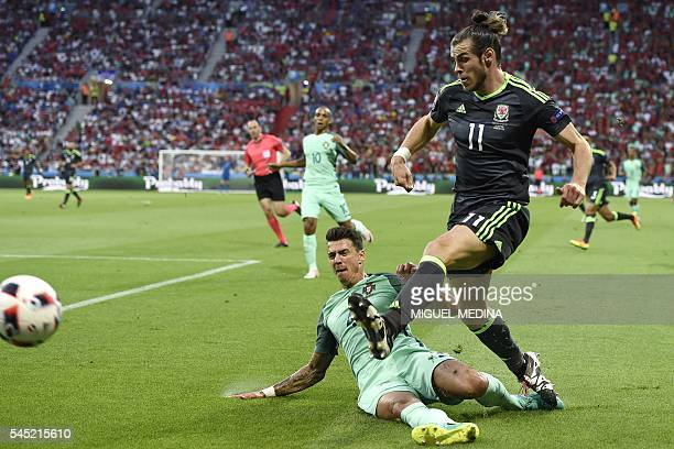 TOPSHOT Portugal's defender Fonte vies for the ball against Wales' forward Gareth Bale during the Euro 2016 semifinal football match between Portugal...