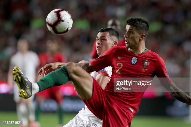 Portugal's defender Joao Cancelo vies with Serbia's forward Nemanja Radonjic during the UEFA EURO 2020 group B qualifying football match Portugal vs...