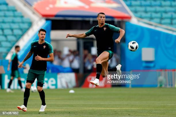 Portugal's defender Jose Fonte and forward Cristiano Ronaldo take part in a training session at the Fisht Olympic Stadium in Sochi on June 14 on the...
