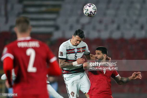 Portugal's defender Jose Fonte fights for the ball with Serbia's forward Aleksandar Mitrovic during the FIFA World Cup Qatar 2022 qualification Group...
