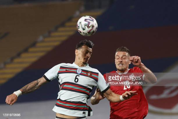 Portugal's defender Jose Fonte fights for the ball with Serbia's midfielder Sergej Milinkovic-Savic during the FIFA World Cup Qatar 2022...