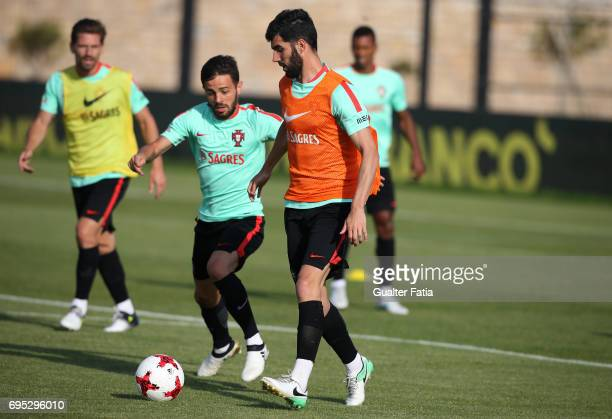 Portugal's defender Luis Neto with Portugal's midfielder Bernardo Silva in action during Portugal's National Team Training session before the 2017...