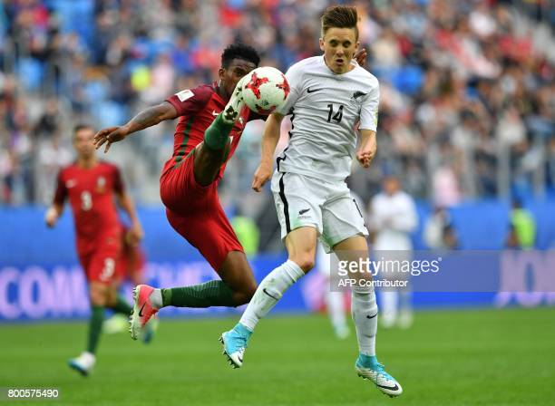 Portugal's defender Nelson Semedo vies with New Zealand's midfielder Ryan Thomas during the 2017 Confederations Cup group A football match between...
