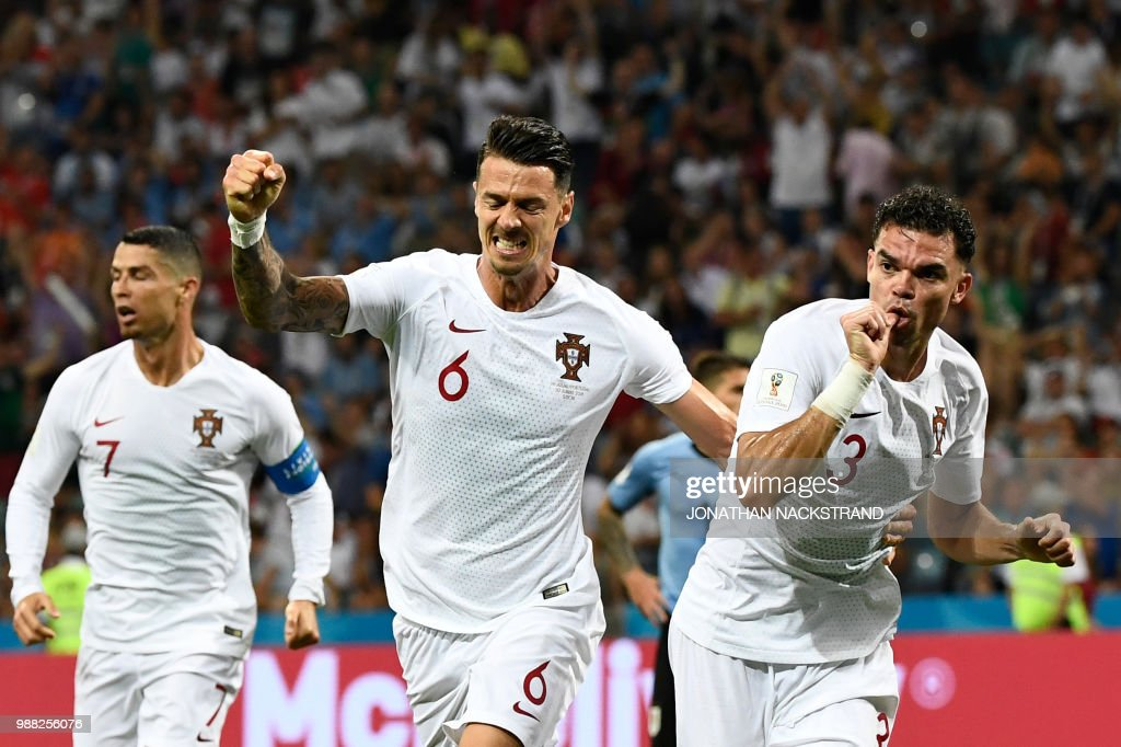TOPSHOT - Portugal's defender Pepe (R) celebrates with Portugal's defender Jose Fonte (C) after scoring the equalizer during the Russia 2018 World Cup round of 16 football match between Uruguay and Portugal at the Fisht Stadium in Sochi on June 30, 2018. (Photo by Jonathan NACKSTRAND / AFP) / RESTRICTED