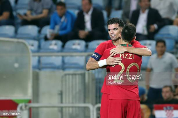 Portugal's defender Pepe celebrates with teammates after scoring during the friendly football match Portugal vs Croatia at the Algarve stadium in...