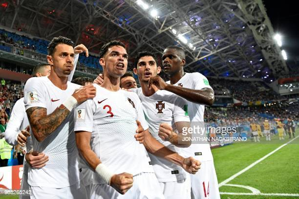TOPSHOT Portugal's defender Pepe celebrates with teammates after scoring the equalizer during the Russia 2018 World Cup round of 16 football match...