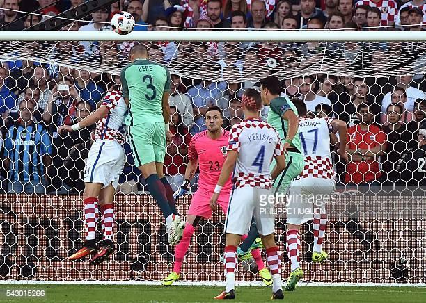 TOPSHOT Portugal's defender Pepe heads the ball as Croatia's goalkeeper Danijel Subasic looks at him during the Euro 2016 round of sixteen football...