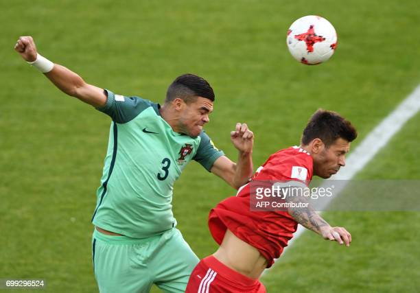 Portugal's defender Pepe heads the ball next to Russia's forward Fedor Smolov during the 2017 Confederations Cup group A football match between...