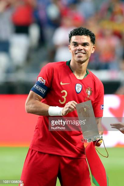 Portugal's defender Pepe is awarded for his 100th game for national team before the UEFA Nations League A group 3 football match Portugal vs Italy at...
