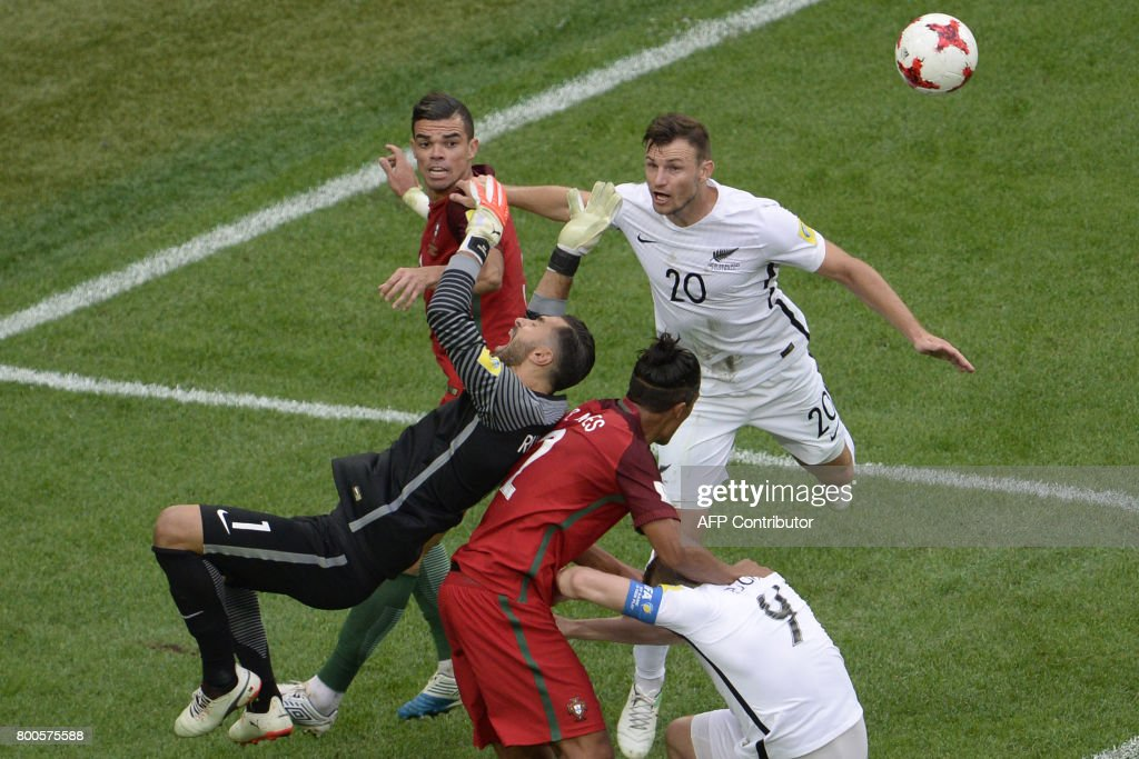 TOPSHOT - (From L) Portugal's defender Pepe, Portugal's goalkeeper Rui Patricio and Portugal's defender Bruno Alves vie with New Zealand's defender Tommy Smith (R) and New Zealand's forward Chris Wood during the 2017 Confederations Cup group A football match between New Zealand and Portugal at the Saint Petersburg Stadium in Saint Petersburg on June 24, 2017. / AFP PHOTO / Olga MALTSEVA