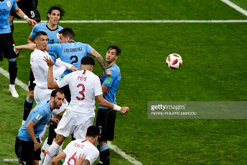 TOPSHOT - Portugal's defender Pepe (C) scores a header during the Russia 2018 World Cup round of 16 football match between Uruguay and Portugal at the Fisht Stadium in Sochi on June 30, 2018. (Photo by PIERRE-PHILIPPE MARCOU / AFP) / RESTRICTED