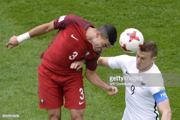 Portugal's defender Pepe vies with New Zealand's forward Chris Wood during the 2017 Confederations Cup group A football match between New Zealand and...