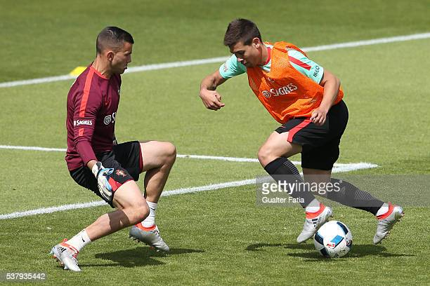 Portugal's defender Raphael Guerreiro with Portugal's goalkeeper Anthony Lopes in action during Portugal's National Team Training session in...