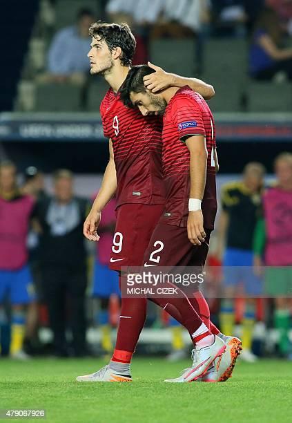 Portugal's defender Ricardo Esgaio and forward Goncalo Paciencia react after the UEFA Under 21 European Championship 2015 final football match...