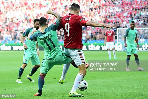 Portugal's defender Vieirinha vies with Hungary's forward Adam Szalai during the Euro 2016 group F football match between Hungary and Portugal at the...