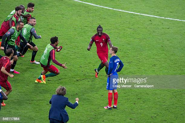 Portugal's Eder celebrates scoring the opening goal with team mates during the UEFA Euro 2016 Final match between Portugal and France at Stade de...