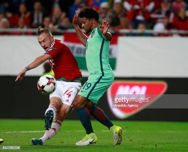 Portugal's Eliseu vies for the ball against Hungary's Gergo Lovrencsics during the FIFA World Cup 2018 qualification football match between Hungary...
