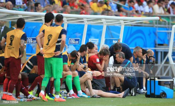 Portugal's Fabio Coentrao is visibly upset on the substitutes bench after he is replaced due to injury