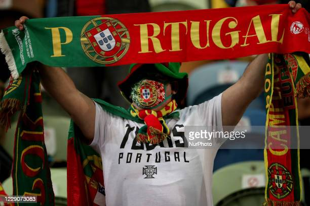 Portugals fan celebrates during the UEFA Nations League group stage match between Portugal and Sweden, at the Jose Alvalade stadium in Lisbon,...