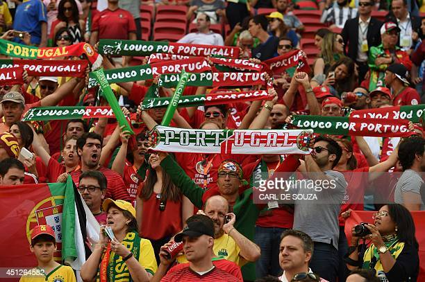 Portugal's fans cheer prior to the Group G football match between Portugal and Ghana at the Mane Garrincha National Stadium in Brasilia during the...