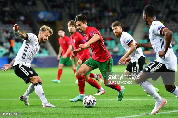 Portugal's Fábio Vieira is challenged by Germany's Niklas Dorsch during the 2021 UEFA European Under-21 Championship final football match between...