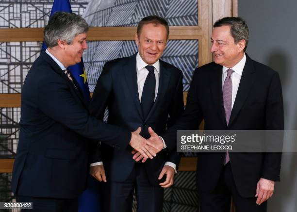 Portugal's Finance Minister and Eurogroup President Mario Centeno and Mario Draghi President of the European Central Bank are welcomed by European...