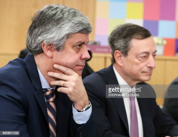 Portugal's Finance Minister and Eurogroup President Mario Centeno and Mario Draghi President of the European Central Bank poses prior to a meeting...