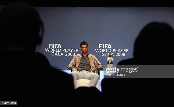 Portugal's football player Cristiano Ronaldo listens during a press conference prior to the FIFA's World Football Player Gala 2008 award ceremony on...