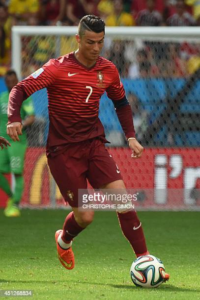 Portugal's forward and captain Cristiano Ronaldo dribbles the ball during the Group G football match between Portugal and Ghana at the Mane Garrincha...