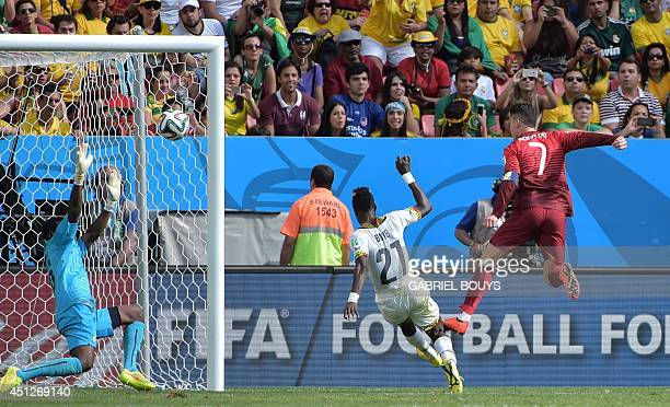 Portugal's forward and captain Cristiano Ronaldo fails to score past Ghana's defender John Boye and Ghana's goalkeeper Fatau Dauda during the Group G...