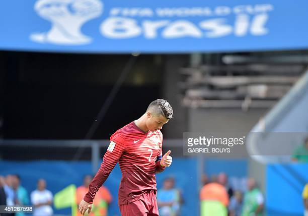 Portugal's forward and captain Cristiano Ronaldo reacts during the Group G football match between Portugal and Ghana at the Mane Garrincha National...