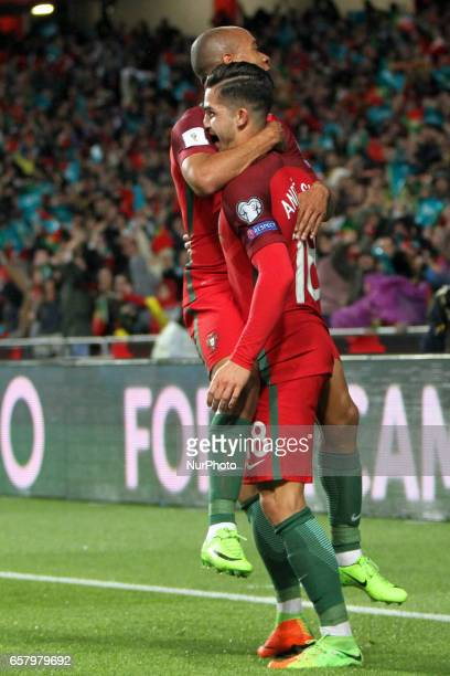 Portugal's forward Andre Silva celebrates after scoring a goal with Portugal's midfielder Joao Mario during the FIFA World Cup Russia 2018 qualifier...