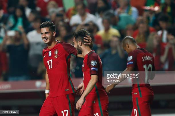 Portugal's forward Andre Silva celebrates his goal with Portugal's midfielder Bernardo Silva during the FIFA World Cup WC 2018 football qualifier...