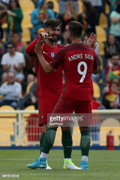 Portugal's forward Andre Silva celebrates with Portugal's midfielder Andre Gomes after scoring during the friendly football match Portugal vs Cyprus...