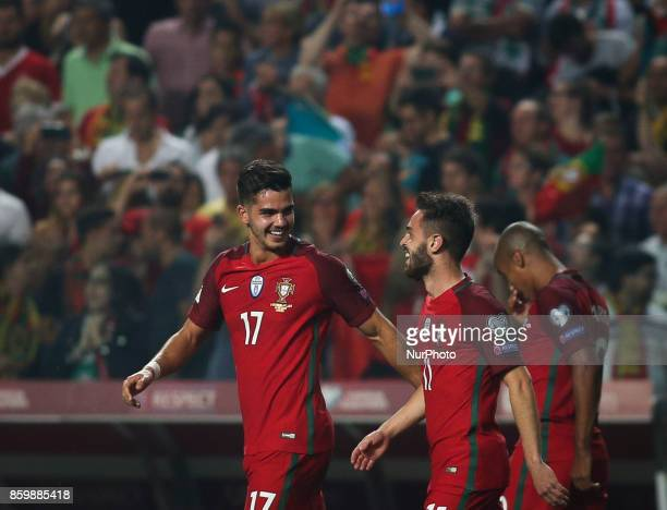 Portugal's forward Andre Silva celebrates with Portugal's midfielder Bernardo Silva after scoring a goal during the FIFA 2018 World Cup Qualifier...