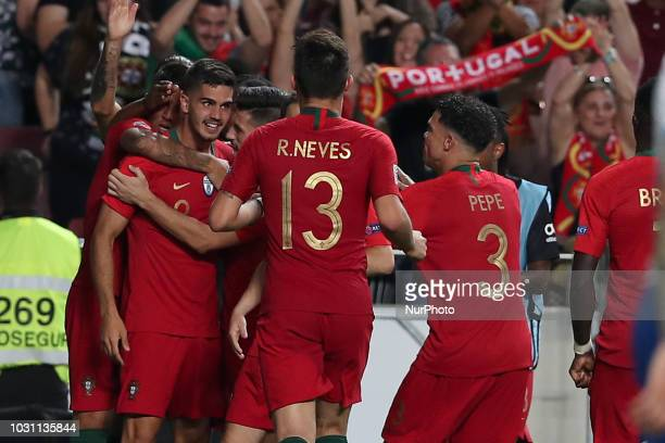 Portugal's forward Andre Silva celebrates with teammates after scoring during the UEFA Nations League A group 3 football match Portugal vs Italy at...