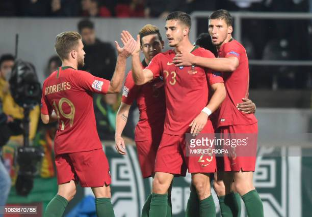 Portugal's forward Andre Silva celebrates with teammates after scoring a goal during the international UEFA Nations League football match between...