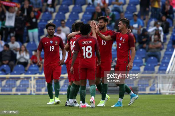 Portugal's forward Andre Silva celebrates with teammates after scoring during the friendly football match Portugal vs Cyprus at Antonio Coimbra da...