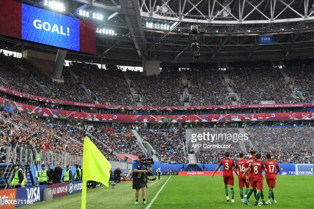 Portugal's forward Andre Silva celebrates with teammates after scoring during the 2017 Confederations Cup group A football match between New Zealand...