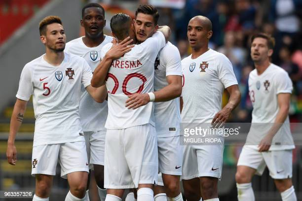Portugal's forward Andre Silva celebrates with teammates after scoring a goal during an international friendly football match between Portugal and...