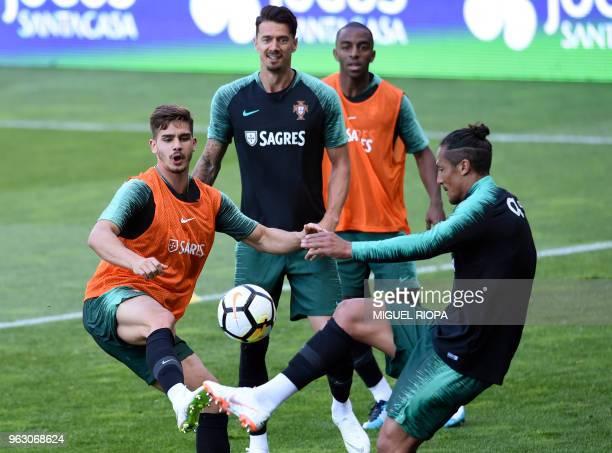 Portugal's forward Andre Silva defender Jose Fonte defender Ricardo Pereira and defender Bruno Alves take part in a training session at the Municipal...